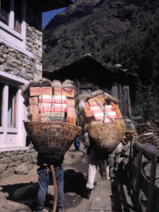 Porters carrying beer and tourist food
